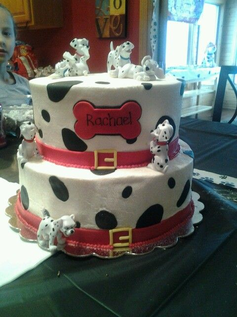 101 Dalmation Cake The characters are plastic, cake is iced in buttercream with fondant accents.  I had to do delivery in a blizzard...the super winds made the frosting crack a little :(