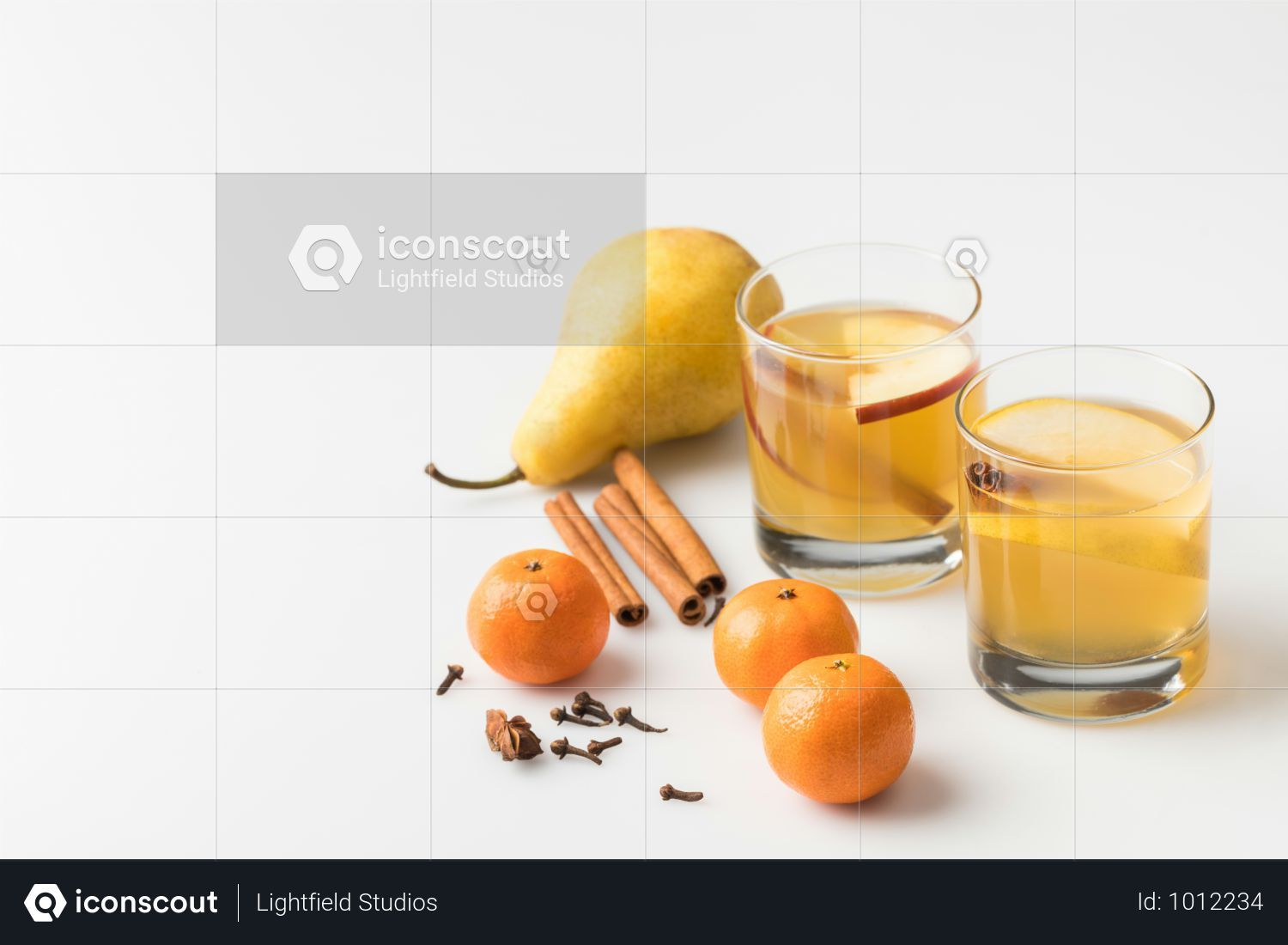 Closeup shot of glasses of cider with pear and tangerines