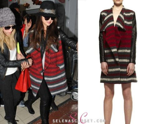 We FINALLY tracked down the coat that Selena Gomez was spotted wearing when she arrived in Paris back in February. She wore this interesting Beckley by Melissa Leather Sleeved Drape Coat. You can find it on Beckley by Melissa's website on sale for $313. Buy it HERE She's also wearing a Forever 21 hat, Stuart Weitzman boots and Dolce and Gabbana bag