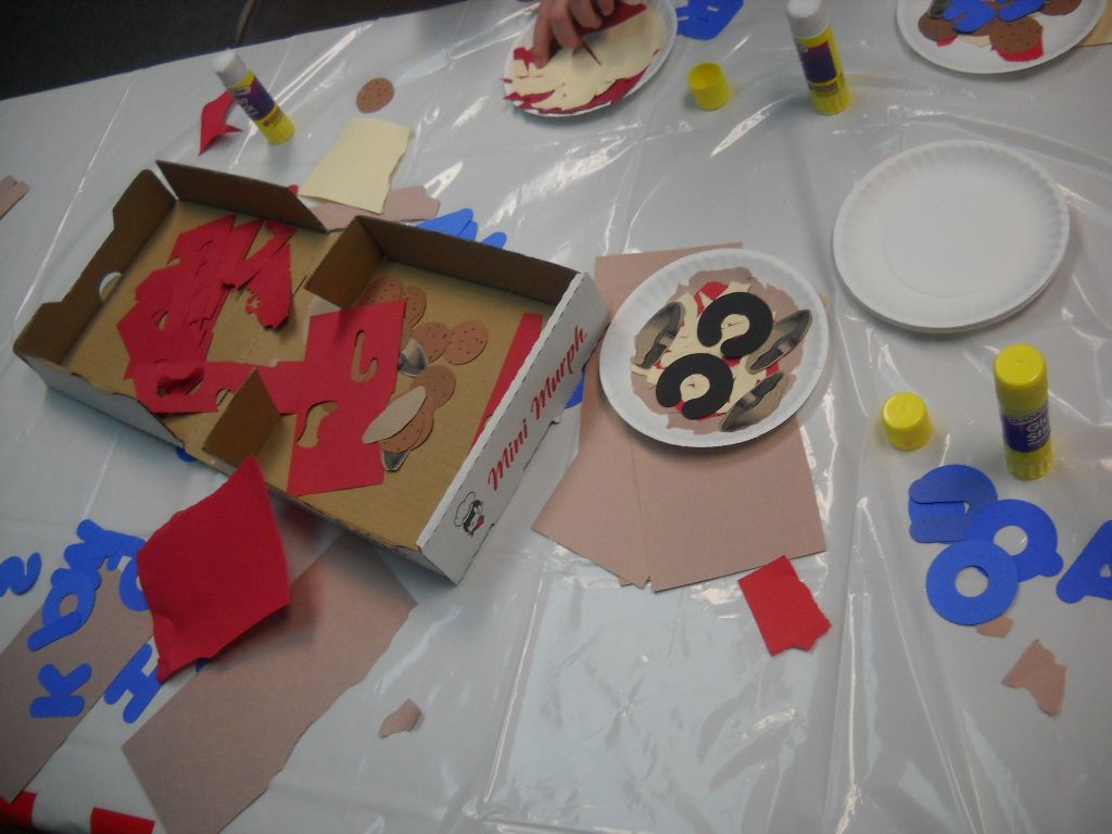Used an old pizza box to house art & craft materials. Kids could make a tiny pizza using paper scraps and then top it withe initial of their first & last name. This was 1 of many stations at our annual literacy event: Itza Pizza theme in 2013.