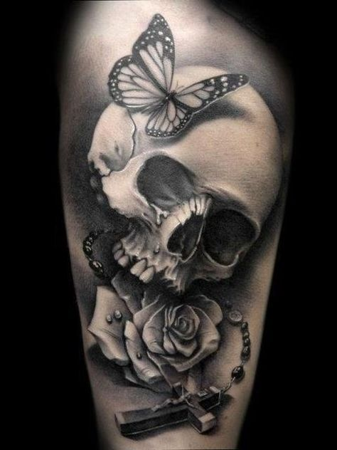 Tatouage Tete De Mort Papillon Rose Et Crucifix Tattoos Skull Tattoo Design Skull Tattoos
