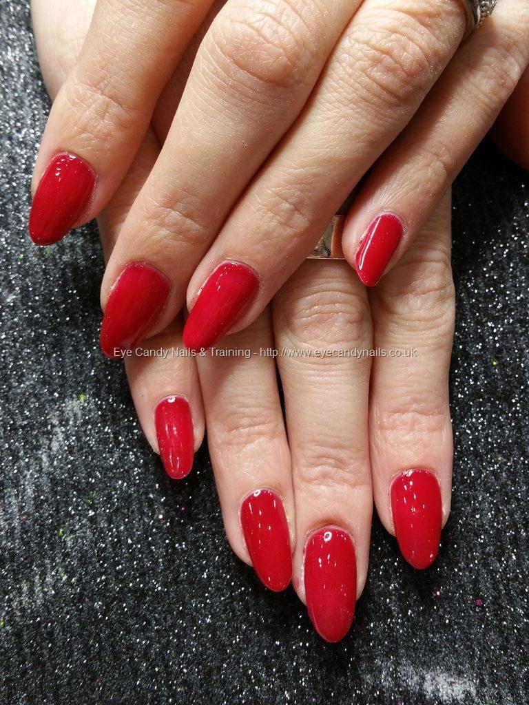 Warm red gel polish on natural nails