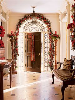 Give your friends and family a festive feeling with lavish decorations that frame your entryway.