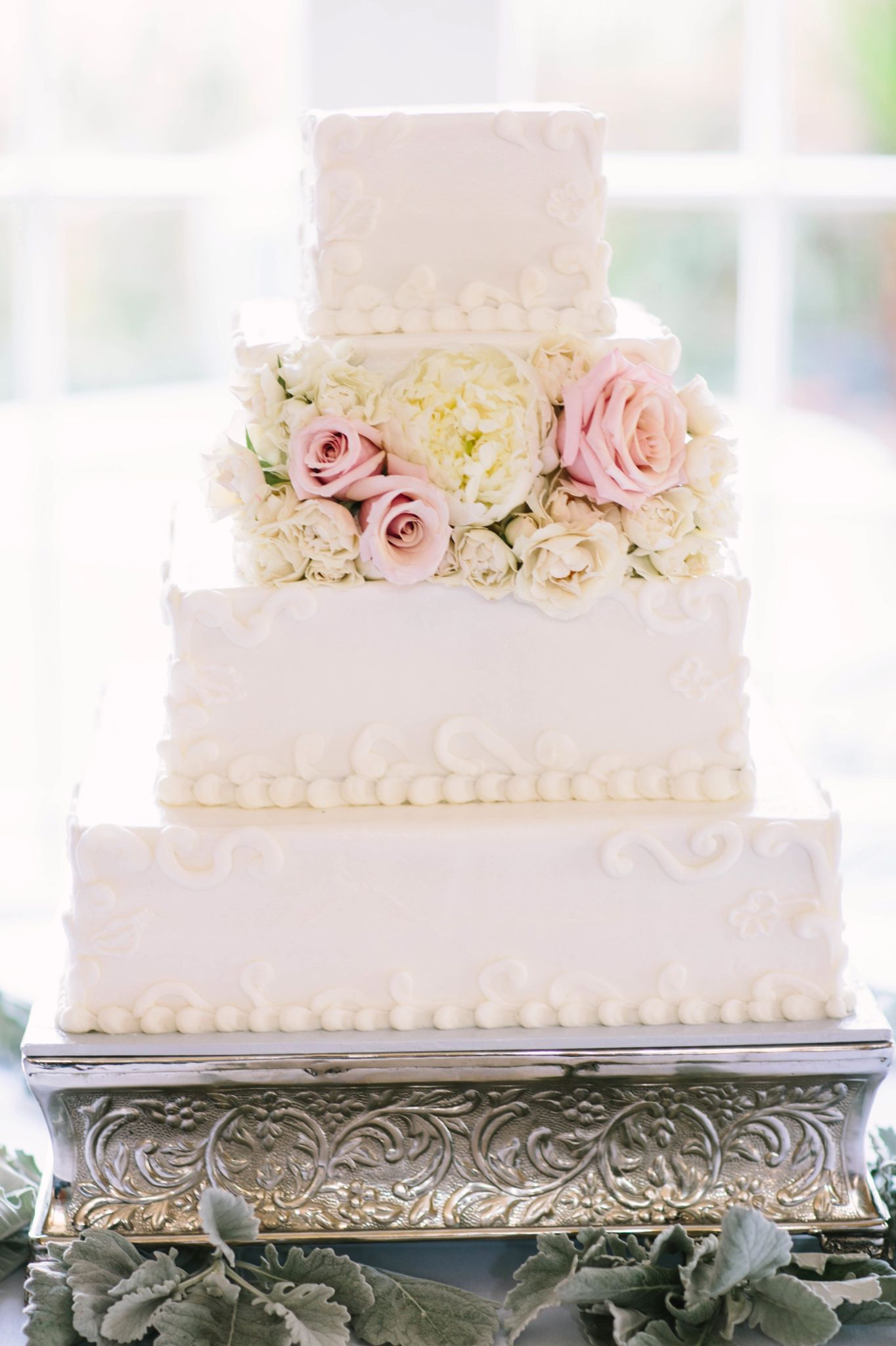 Square butter cream wedding cake with Ivory peony, spray roses with ...