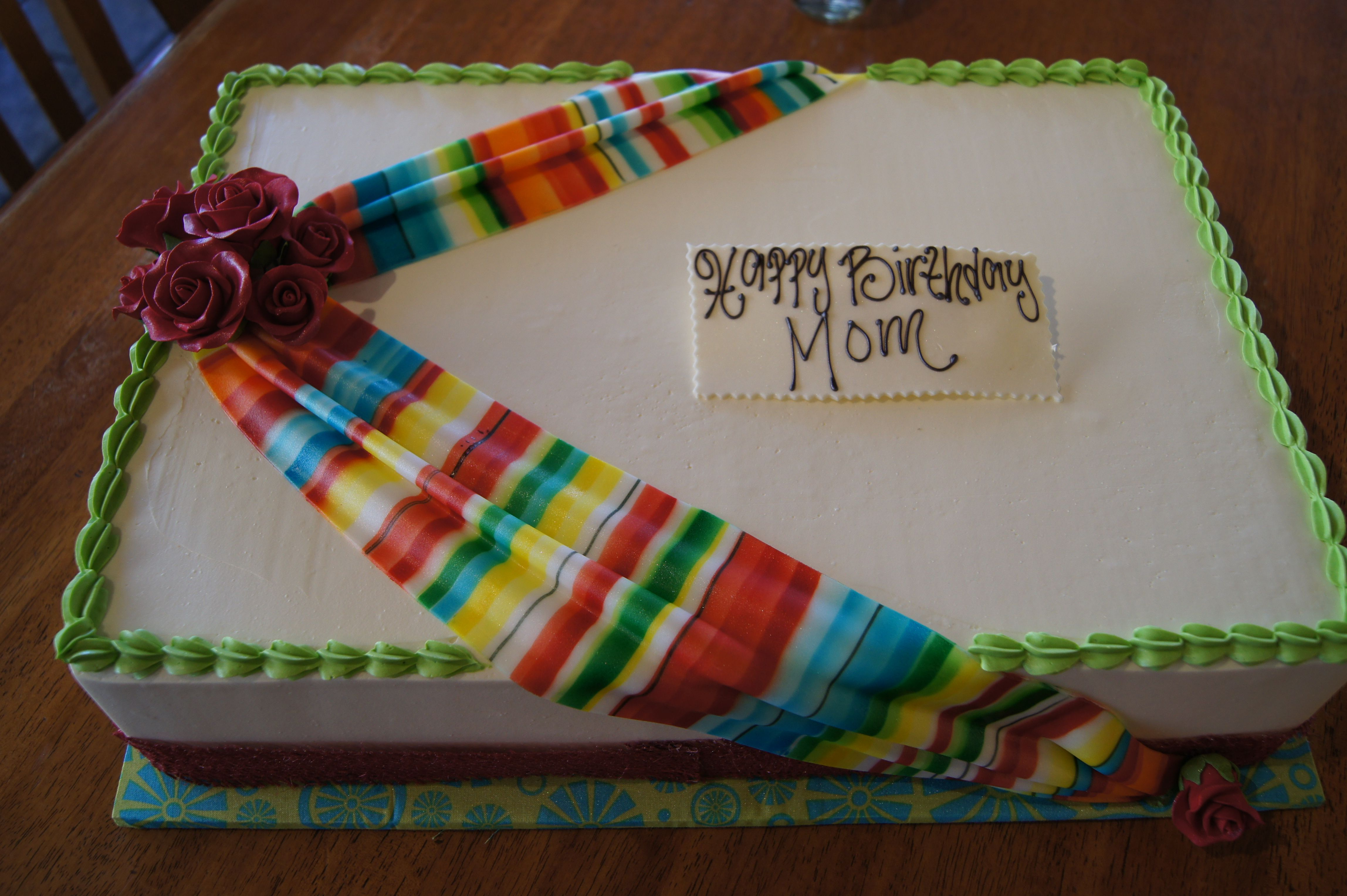 Birthday sheet cake with colorful draped fondant and red