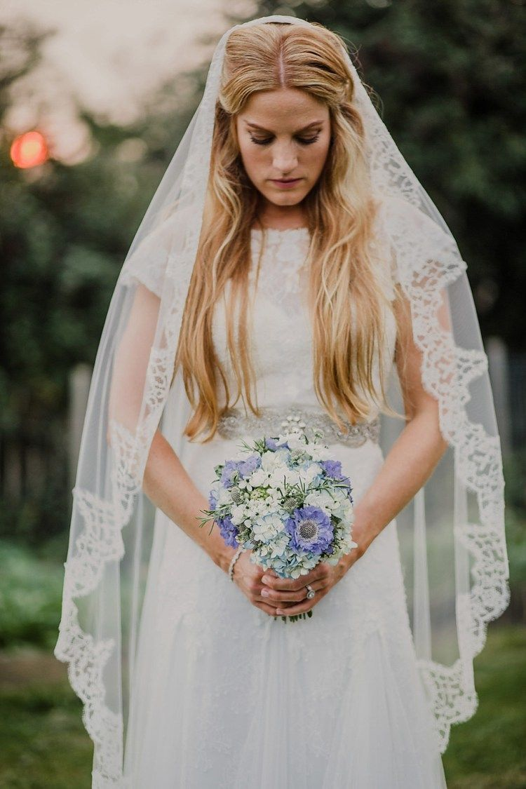 An elegant cymbeline gown for a pale blue rustic style september