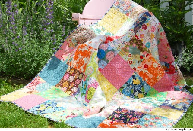Bohemian Squares Quilt is part of Square quilt, Bohemian quilt, Quilts, Cozy quilts, Floral quilt, Patchwork patterns - I can't believe it's taken me this long to share my newest quilt with you! After I showed you all the fabrics I had gotten to put in it , I just kind of got it all done lickety split! It's been finished for a few weeks now, so I'm glad to finally share it  This quilt was such a huge departure for