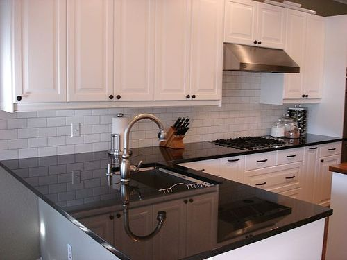 white kitchen cabinets with black granite countertops i like the white subway tile backsplash with the 28979