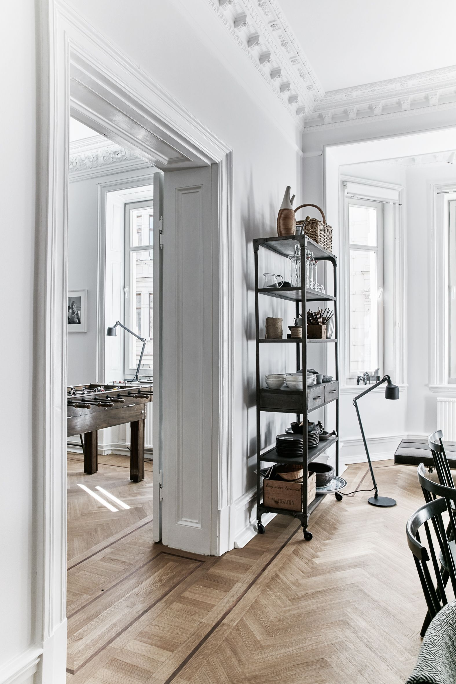 French style apartment herringbone floors vipp lamps and natural light in a modern home of 4 in gothenburg sweden