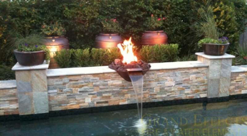 Fire water bowl set into a stacked stone raised wall - Pool fire bowls ...