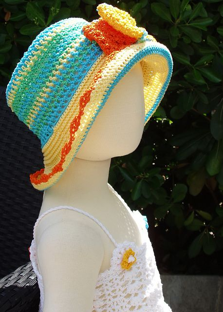 Ravelry: CROCHETSUN HAT WITH FLOWERS AND BOW   pattern by Ingunn Santini
