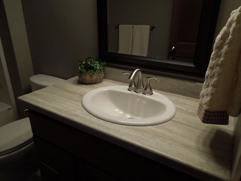 A Bathroom Vanity With Formica 180fx Travertine Silver Laminate