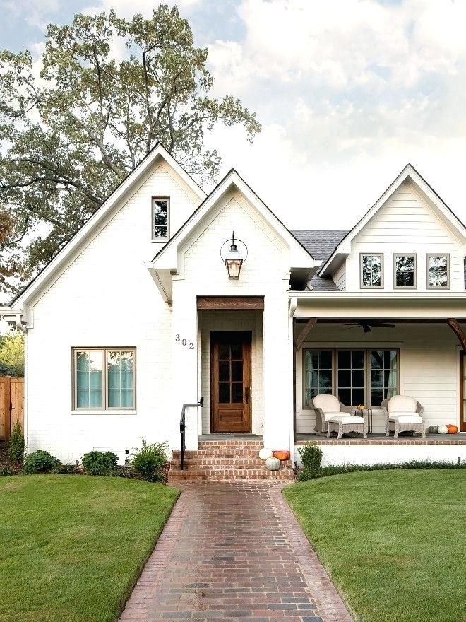 white painted brick house white brick wood front door porch cool ...