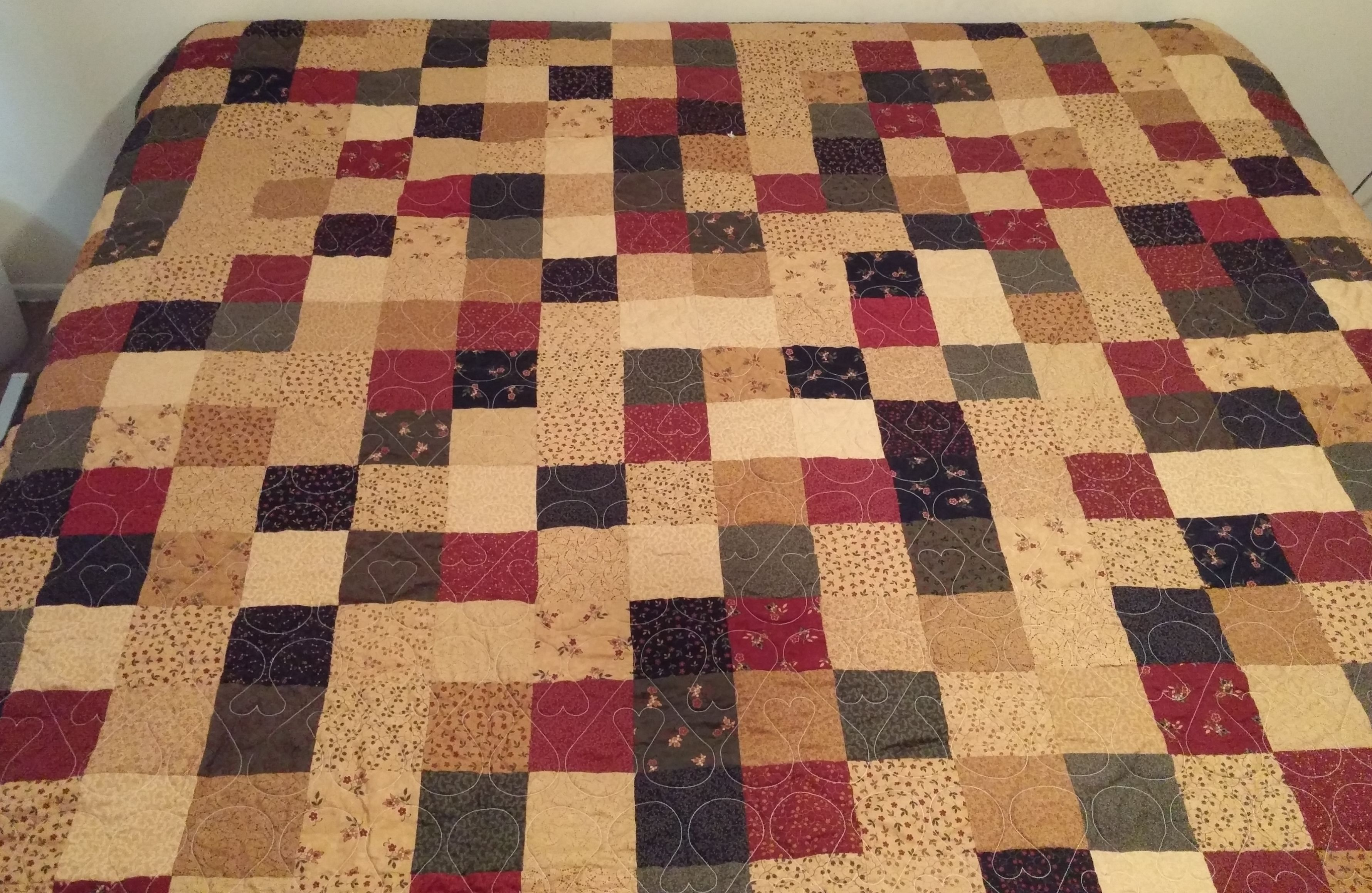 Queen size made with 5 inch squares. Quilted with Heart with in a heart quilting pattern.
