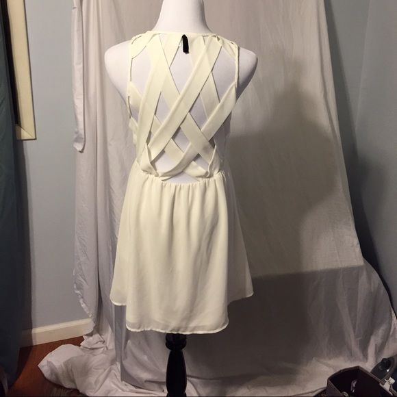 Divided by H&M sleeveless dress Elastic waist. Beautiful criss cross detail in back. Above knee. Washable polyester Divided Dresses