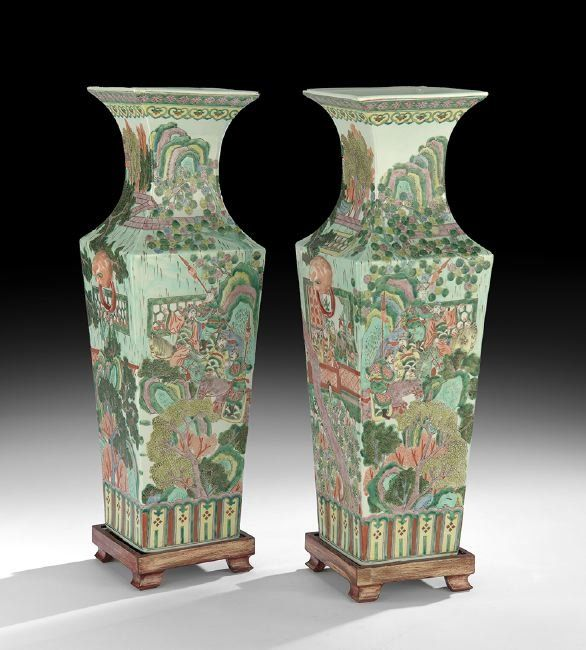 """Pair of Chinese Famille Verte Porcelain Vases, Qing Dynasty (1644-1911), the two rectangular vases decorated with scenes of the emperor and his entourage, the underside bearing a six-character Kangxi reign (1662-1722) mark in red, with custom-carved and molded wooden stands, h. 24"""", w. 8-1/2"""", without stands."""