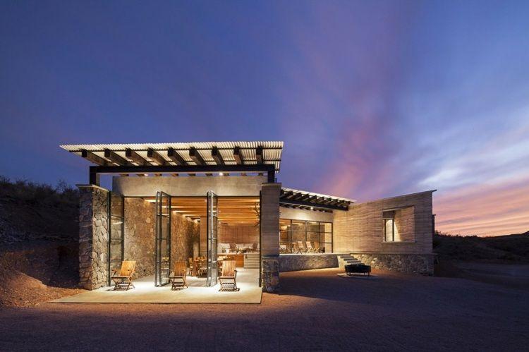 terrasse de la maison écolo avec baie vitrée à portes accordéon