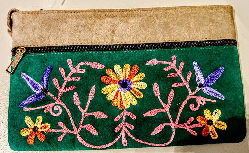 Women hand bag embroidery available in many different colors