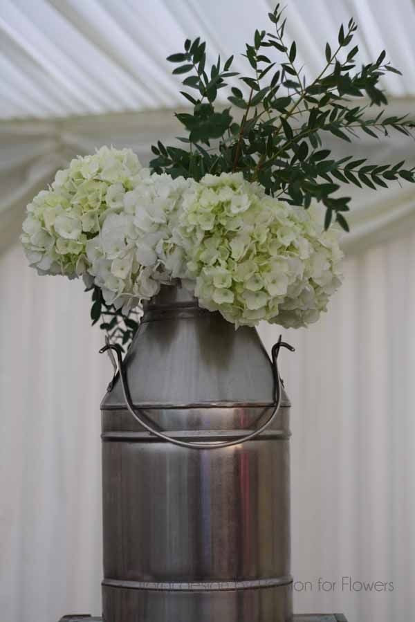 Urn with country flowers by Passion for Flowers
