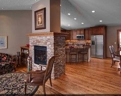 Fireplace In Middle Of Living Dining Room Home Fireplace Fireplace Design Brown Living Room Decor