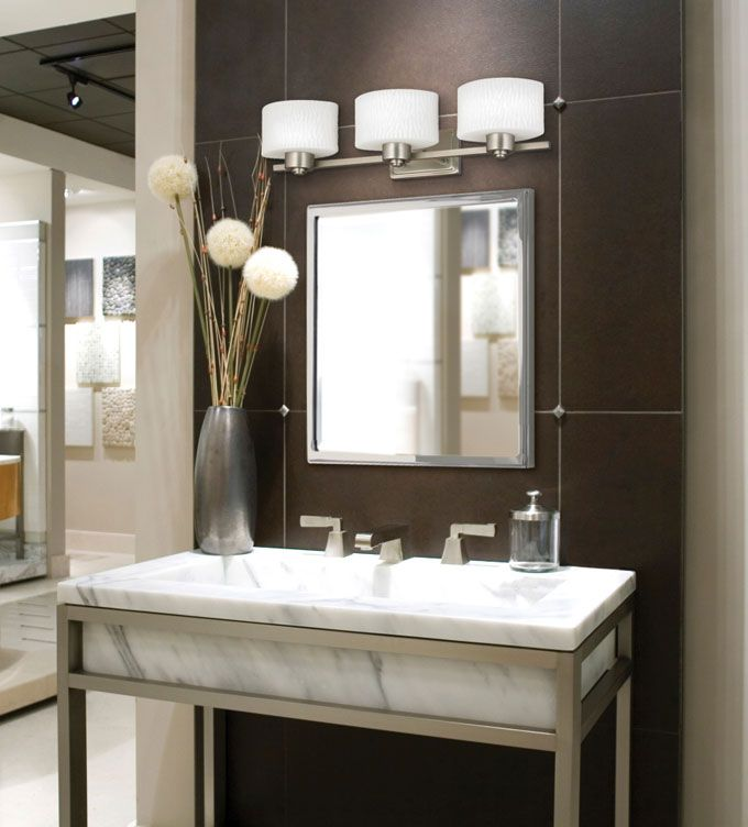 From Blah To Spa How Bathroom Lighting Can Turn Your Space Into An Oasis Bellacor Bright Ideas Blog Light Fixtures Bathroom Vanity Contemporary Bathroom Lighting Modern Bathroom Vanity Lighting Bathroom light fixtures over mirror