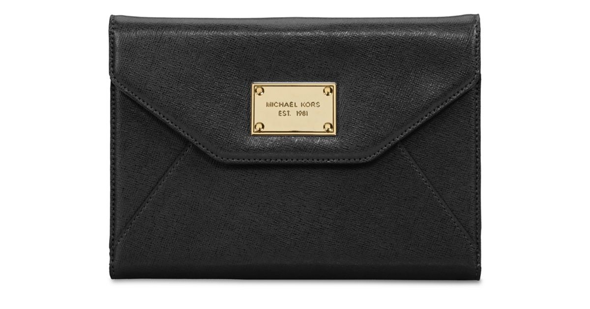 The MICHAEL Michael Kors Clutch is a premium leather designer clutch that beautifully protects your iPad mini, while providing space for credit cards and cash.