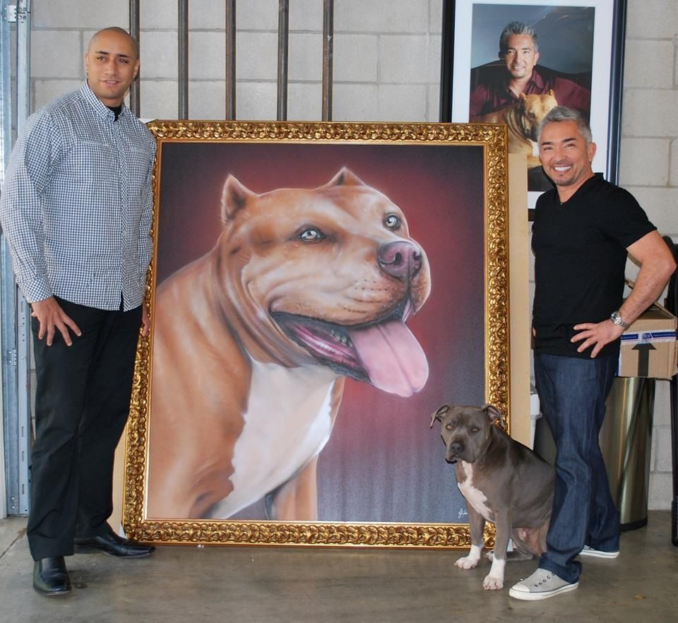 Cesar Millan portrait of 'Daddy' Puppy biting, Dog