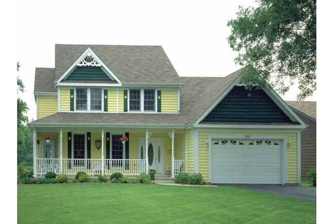 Yellow Victorian with gingerbread trim and scalloped accent siding.