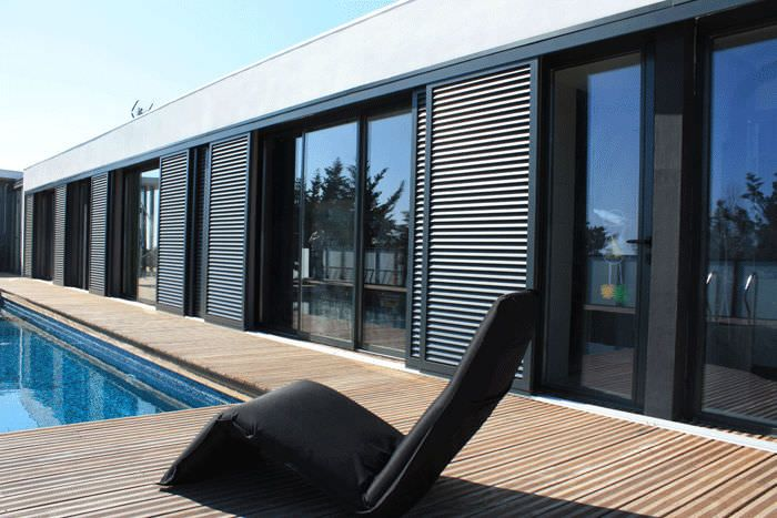 Sliding shutters / aluminum / for facades / thermal break TAOS® PROFILS SYSTEMES