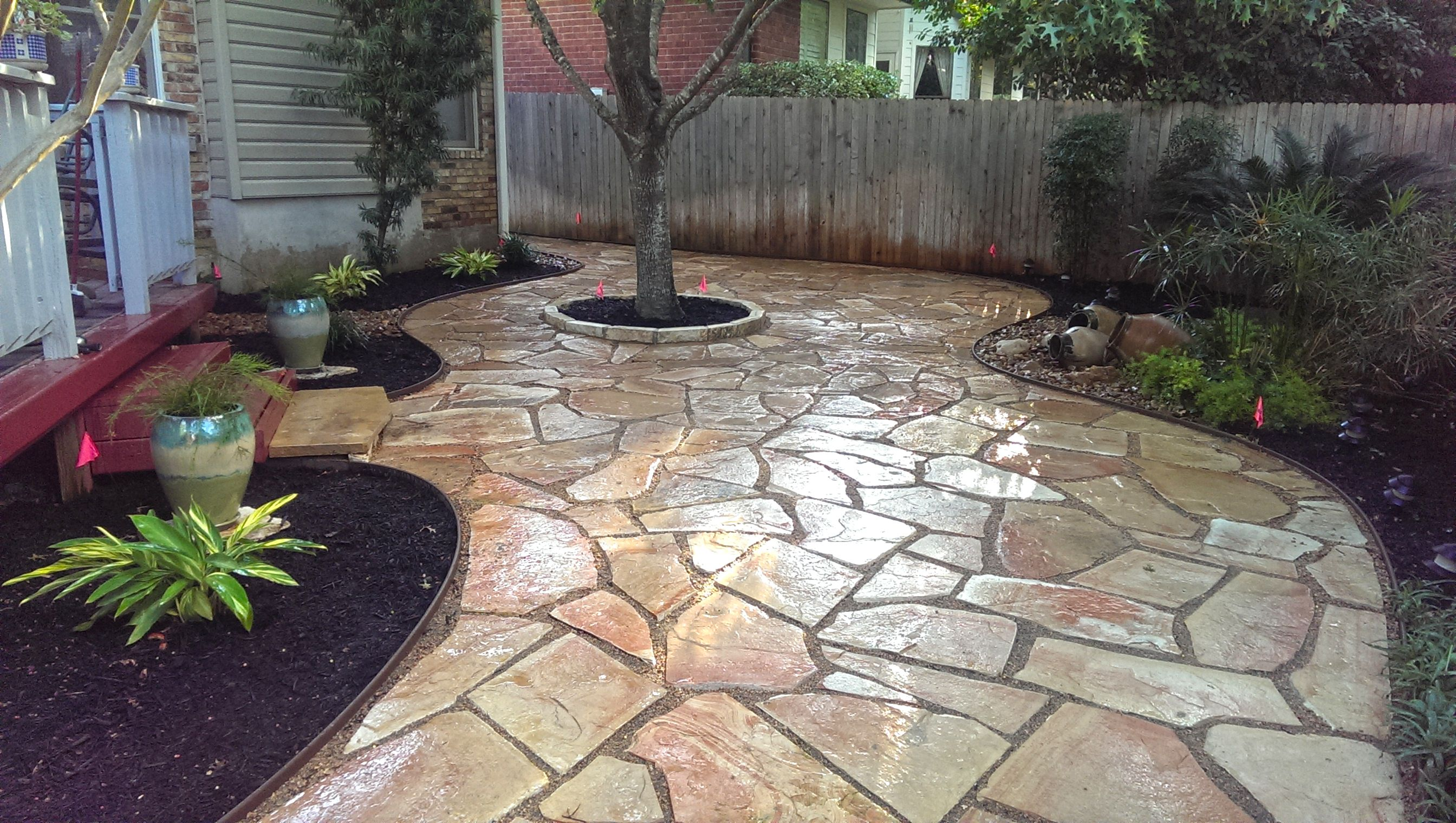 Backyard Landscape Flagstone Patio Tree Ring And Vase Fountain