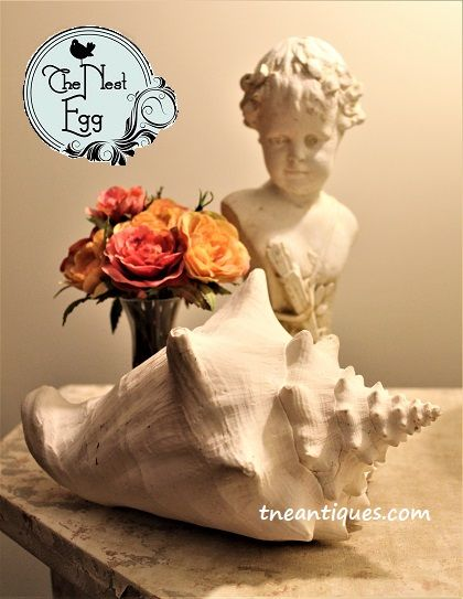 Soft colors for Valentines--an old plaster Cupid statue from France, a shell and roses.
