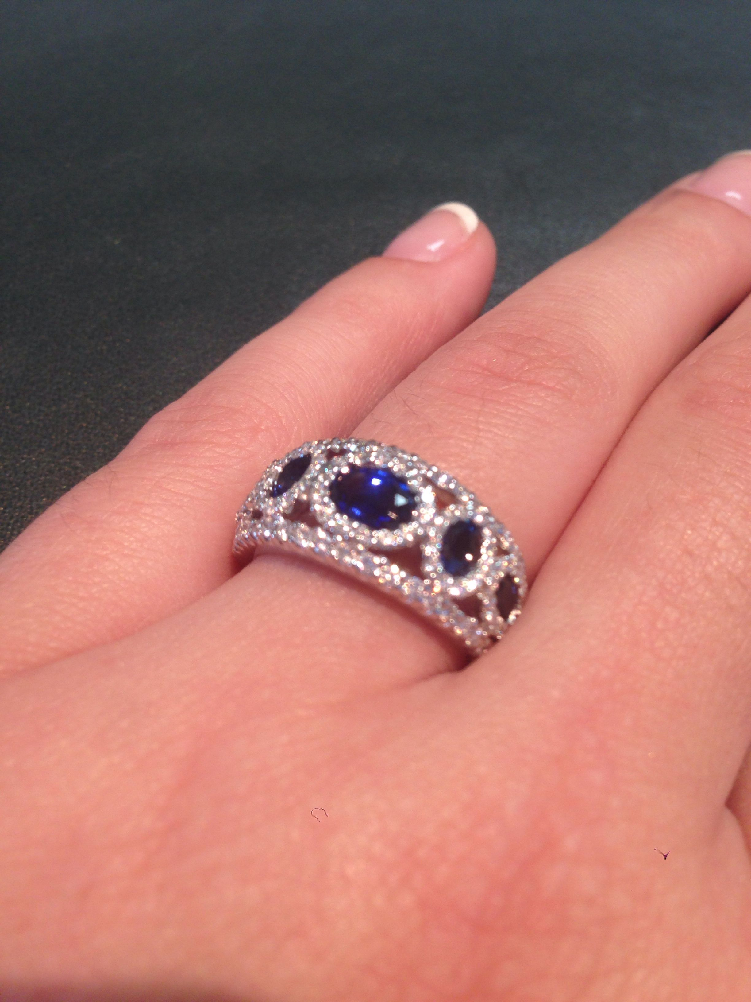This beauty has 5 unique sapphires accented by 100 round brilliant ...