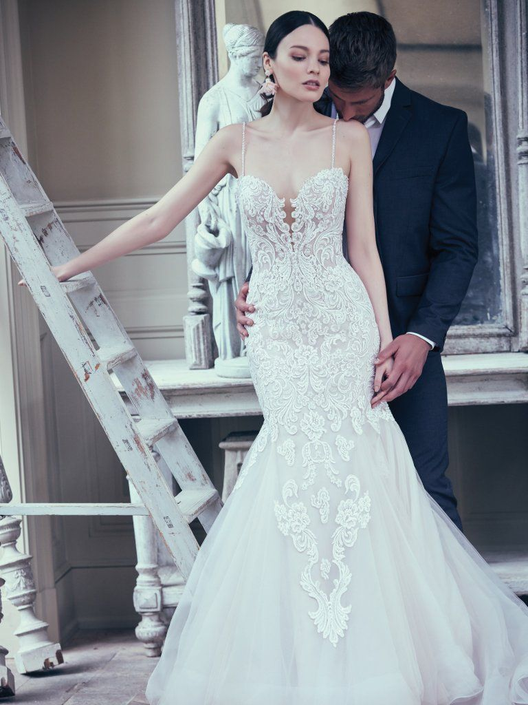 23374568c ALISTAIRE: This glamorous fit-and-flare wedding gown features a bodice of  lace