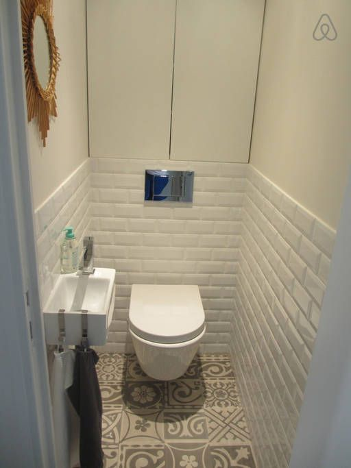 Tiny white brick tiled toilet modern wall hung very clean ...