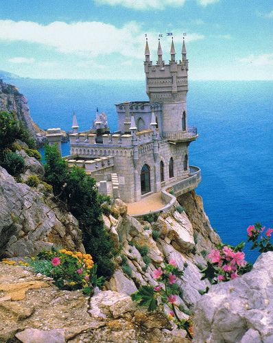 Swallow's Nest, is a decorative Castle near Yalta on the Crimea shore in southern Ukraine. It was built between 1911-1912, on top of 40-meter (130 ft) high Aurora Cliff, overlooks the Black Sea and is situated near the remains of an ancient Roman fortress.