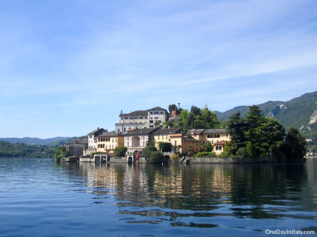 The Mystical Isle of San Giulio | The tiny, mystical island of San Giulio sits in the middle of Lago di Orta, whispering across the lake to the tourists sipping on spritz in Orta's picturesque main square. After just a short boat ride, you can discover its secrets for yourself | Italian Travel & Culture Blog | OneDayInItaly.com