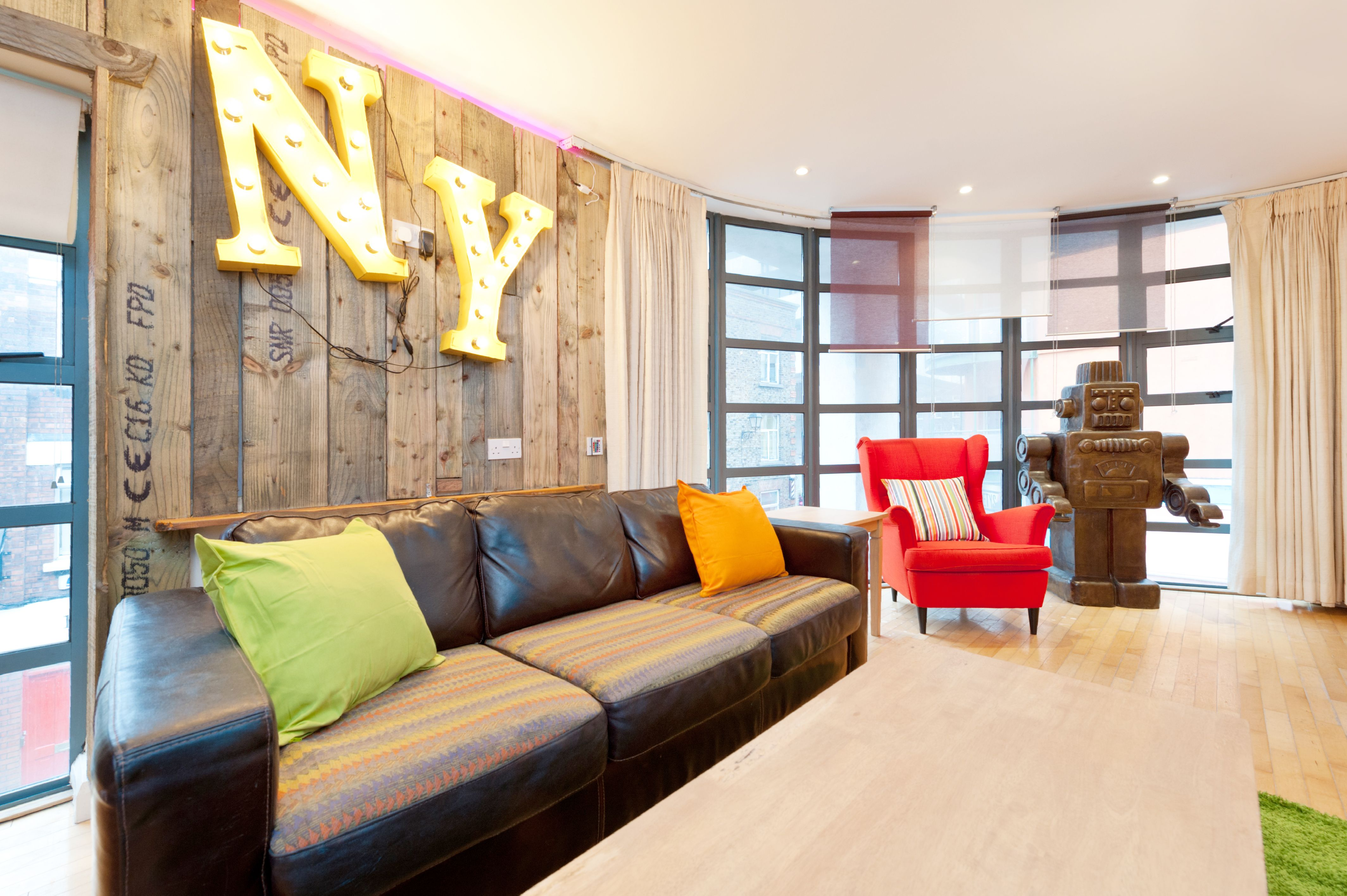 With lots of lighting and a bright sitting room, it is a