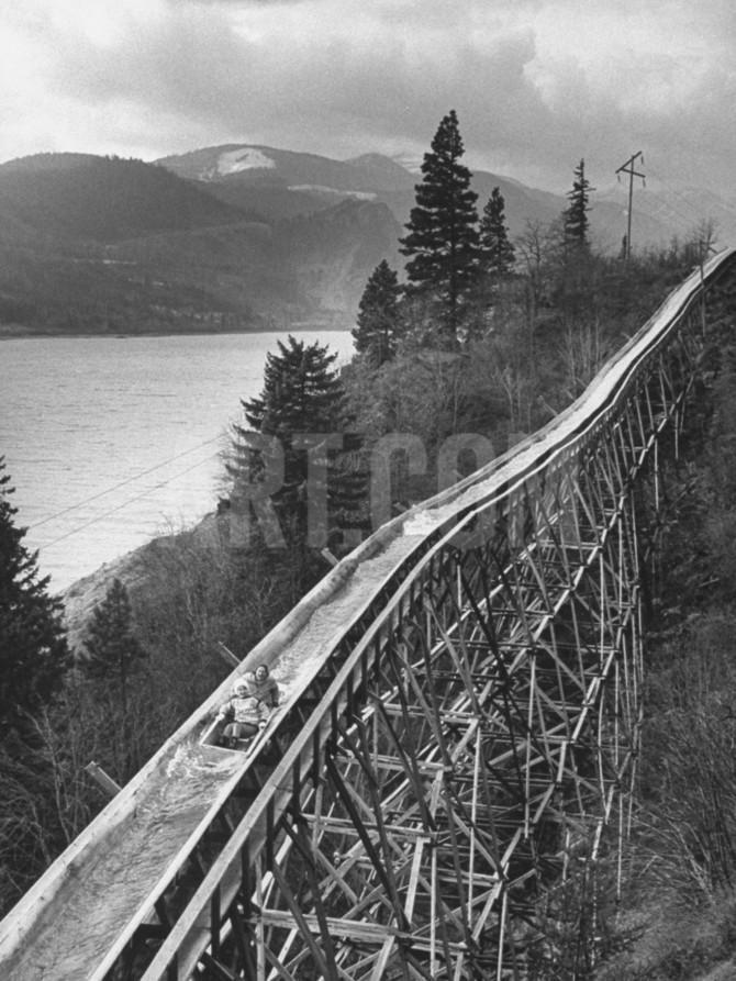 Joy-Riders Taking Boat Ride Down Logging Chute Premium Photographic Print by…