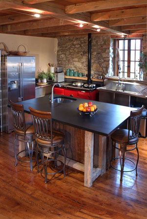 Old Barn Beams And Planks Were Used To Make The Kitchen