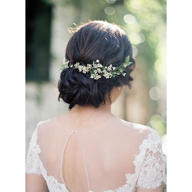 love this simple soft low-bun - but will have minimal florals on one side, as I'll be wearing a simple veil directly over my bun during the ceremony