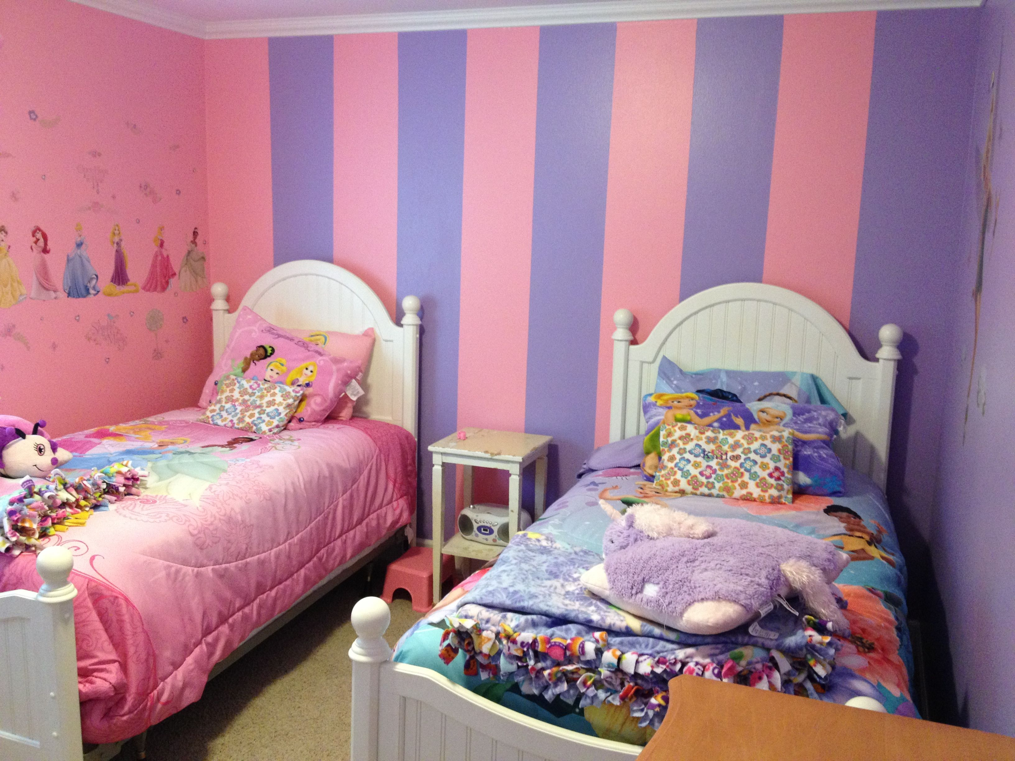 Room for twin girls e wall is pink and one purple e wall has