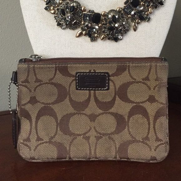 Coach Wristlet Coach Wristlet. Brown. Leather zip strap. Wear on corners from use. Coach Bags Clutches & Wristlets