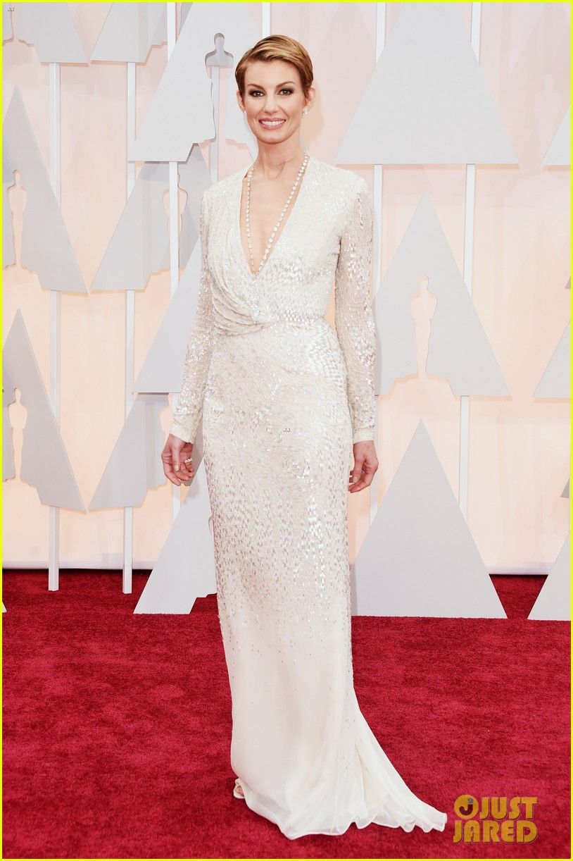 Tim McGraw Jokingly Bites Wife Faith Hill at Oscars 2015