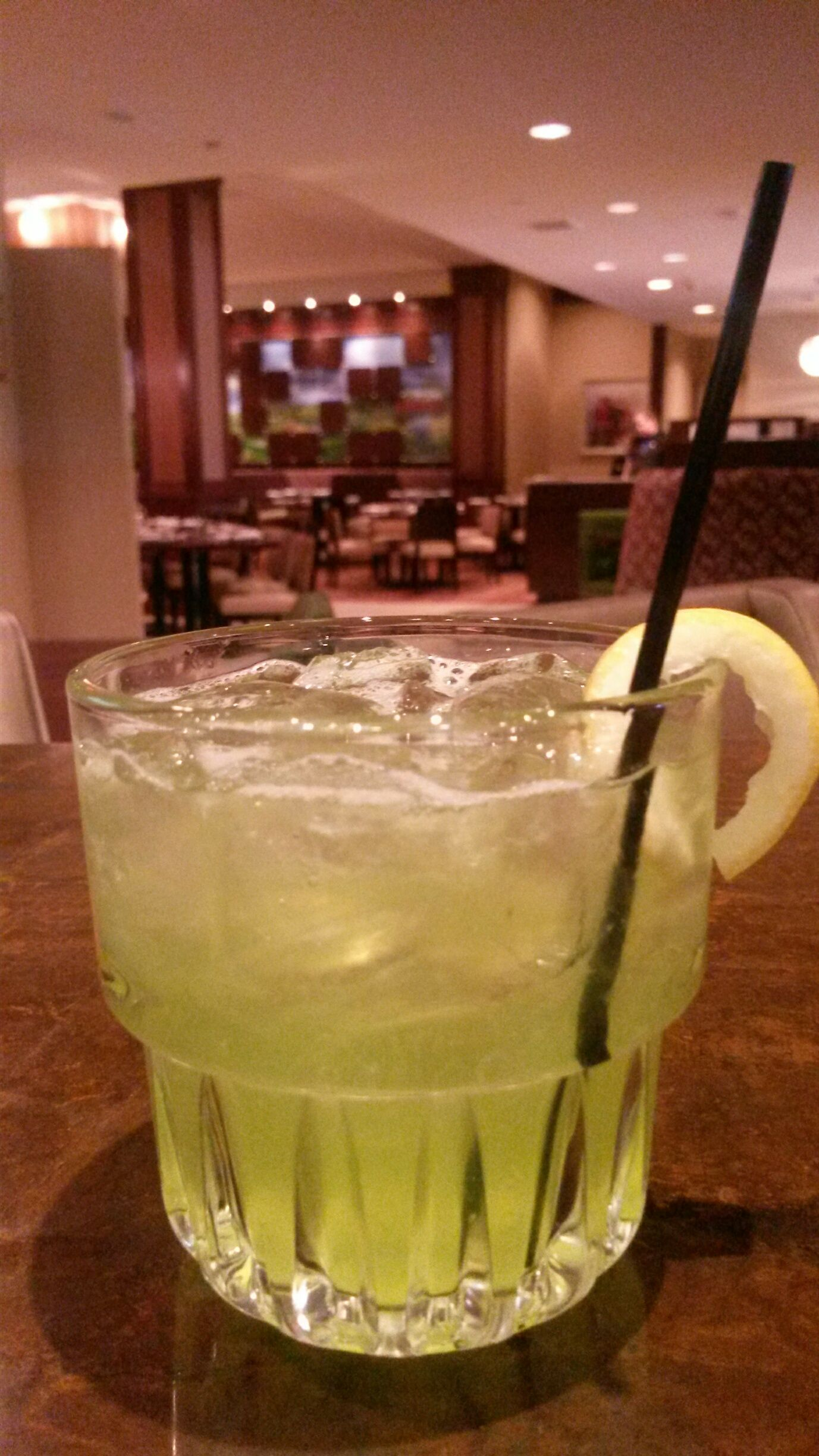 Two Rivers Grille ~ South Side Splash Cocktail Made With Green Tea Honey Midori And Local Broadbent Unaged Corn Whiskey From Norwalk Iowa And Lemon Twist