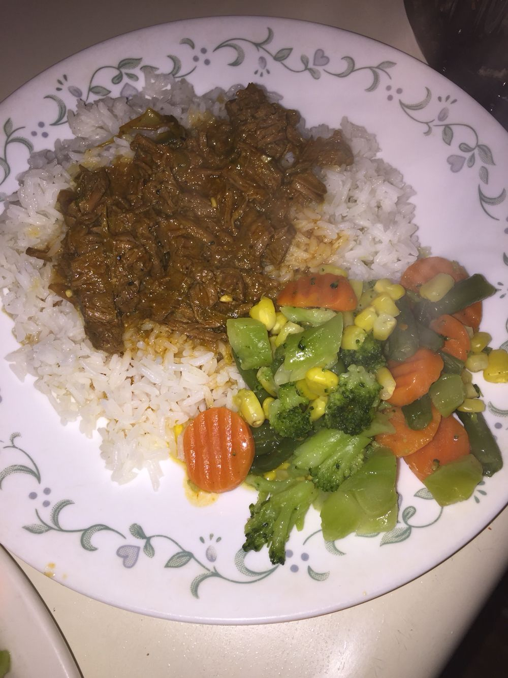 Steak in slow cooker. Topped of white rice.  Veggies on side