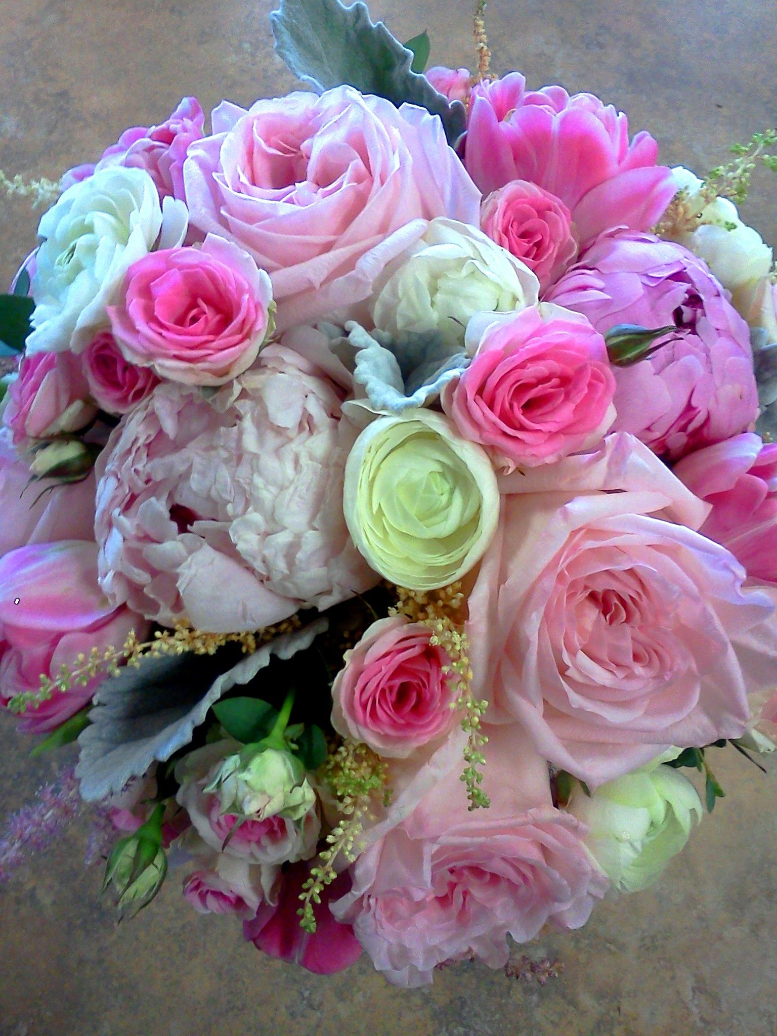 Beautiful pink peony rose dusty miller and lizzie bridal bouquet peonies garden roses mini roses with other accent flowers in a bouquet holder izmirmasajfo