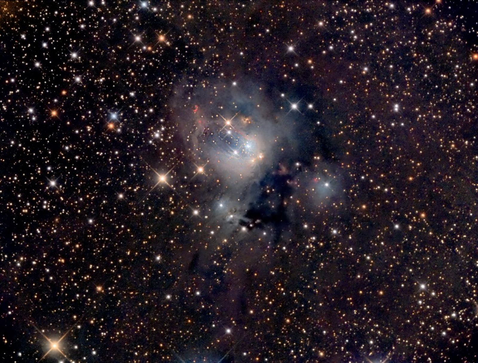 https://flic.kr/p/T4LxAs | NGC 7129 | Reflection nebula about 3300 light years away in the constellation Cepheus. The brighter stars form a young cluster responsible for lighting the nebula. A small, circular red arc can be seen along with a large whispy arc below it that is formed by jets from the bright stars in the center.
