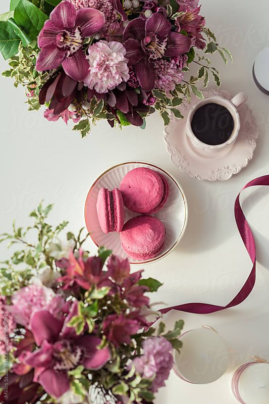 Beautiful workplace with flowers bouquets, coffee cup, ribbon and macaroons Download this high-resolution stock photo by MILLES STUDIO from Stocksy United.