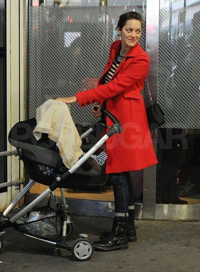 Marion Takes Baby Marcel Along For a Flight to NYC: Marion Cotillard pushed baby Marcel through JFK.