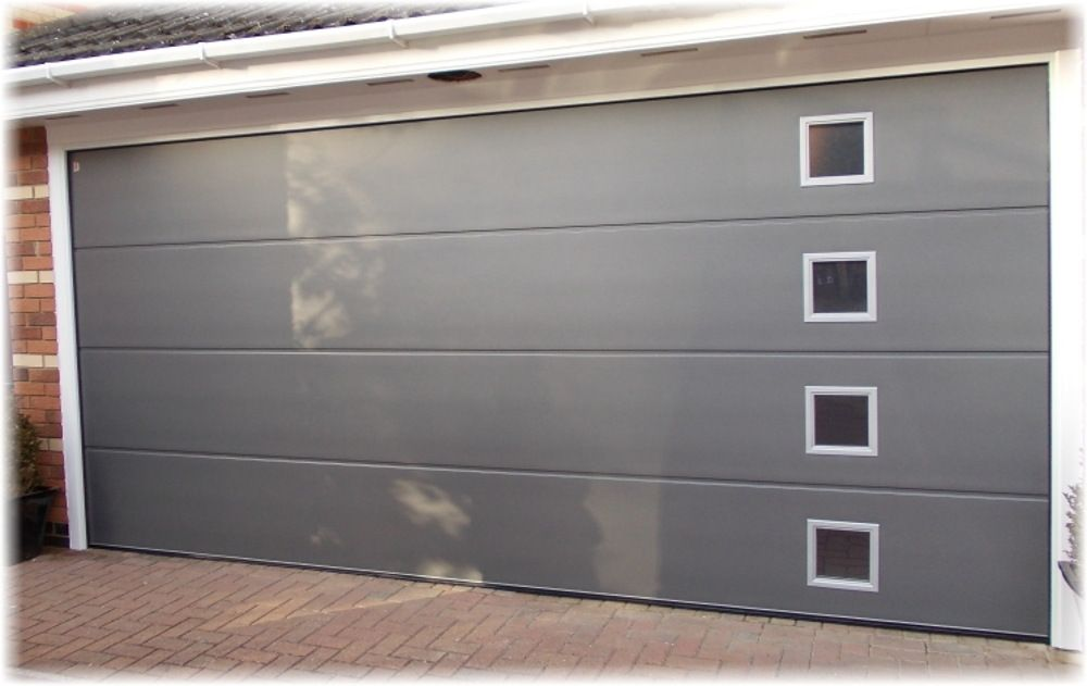 Tailored to fit any space or style sectional doors from SA Garage Doors come in a choice of materials colours finishes and even insulating properties in ... & Tailored to fit any space or style sectional doors from SA Garage ...